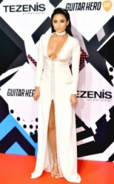 Shay Mitchell on the red carpet, dares to bare, dressed in a plunging long sleeved column gown with high center slit at the 2015 MTV EMA's, Milan, Italy, 25 October 2015. Celebrity fashion | star style | event gowns | celebrities at events
