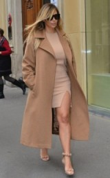 Kim Kardashian street style chic dressed in a nude bodycon dress, embellished sandals and a classic camel coat. Celebrity fashion | star style | Kim's outfits | Kardashian fashion