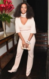 Solange Knowles looking chic in this cream ensemble, attends the CFDA/Vogue Fashion Fund Show at Chateau Marmont in Hollywood, October 2015. Celebrity fashion | star style | events | outfits