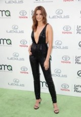 Stana Katic wearing a plunging black sequined jumpsuit at the EMA Awards in Burbank, Los Angeles, Oct 2015. Celebrity style | embellished jumpsuits | events