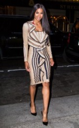 Ciara looking chic in this striped Givenchy dress with front ruffle, out for the evening in New York City. Celebrity fashion | star style | designer dresses
