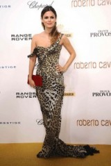Rachel Bilson in 2010, attending an event in Paris, looked glamorous as well as elegant wearing this Roberto Cavalli leopard print gown. Animal prints – designer gowns – glamour