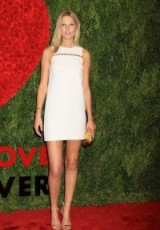Model Toni Garrn in a white sleeveless mini dress attends the God's Love We Deliver, Golden Heart Awards in New York, Oct 2015. Celebrity style – red carpet fashion – events
