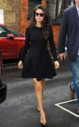 Selena Gomez in a black long sleeved fit and flare dress with animal print pointy pumps. Celebrity fashion | chic outfits | star style | LBD | skater dresses