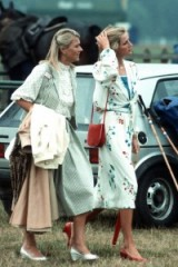 Princess Diana at a polo match in July 1983 wearing a floral tie front blouse with a matching skirt designed by Donald Campbell, first worn on her Honeymoon in 1981, teamed with red accessories. Diana's style ~ royal fashion ~ royalty ~ outfits