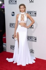 Gigi Hadid looked perfect on the red carpet in this white custom Bao Tranchi ensemble at the American Music Awards, Nov 2015. Celebrity style / event outfits / designer fashion / AMAs