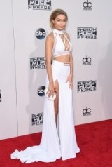 Gigi Hadid looked gorgeous on the red carpet in a white custom Bao Tranchi outfit when she attended the American Music Awards, Nov 2015. Celebrity style / event outfits / designer co-ords / AMAs
