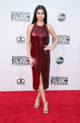 Selena Gomez wore a red sequin Givenchy halter dress at the American Music Awards, Nov 2015. Celebrity style / event outfits / AMAs / red carpet dresses / designer fashion