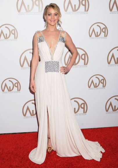 Jennifer Lawrence's red carpet style – wearing a white plunging Prada gown, embellished with beads and crystals, with her hair up in a loose updo, at the Producers Guild Awards in January 2015. Celebrity fashion | celebrities at events | designer gowns | star style - flipped