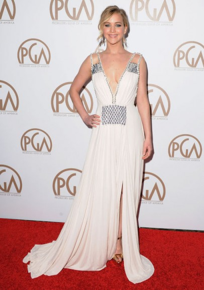Jennifer Lawrence's red carpet style – wearing a white plunging Prada gown, embellished with beads and crystals, with her hair up in a loose updo, at the Producers Guild Awards in January 2015. Celebrity fashion | celebrities at events | designer gowns | star style