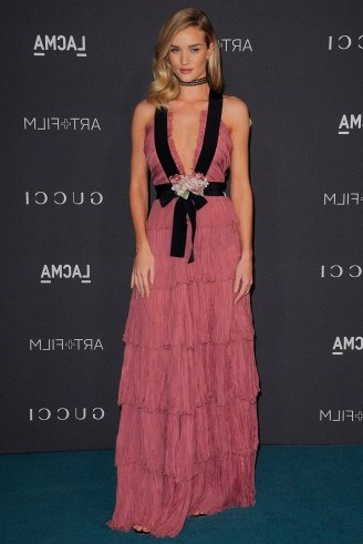 Rosie Huntington-Whiteley looked a dream in this rose pink plunging Gucci gown at the LACMA Art & Film Gala, presented by Gucci, 7 November 2015. Celebrity fashion | star style | tiered gowns | what celebrities wear to events | Los Angeles County Museum of Art - flipped