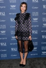 Dasha Zhukova wearing a printed long sleeve mini dress, decorated with sheer ruffles as well as a sheer midi hemline – WSJ Innovator Awards in NYC, Nov 2015. Celebrity style / dresses / event fashion