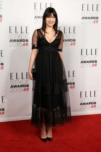 Daisy Lowe Wearing A Black Plunge Neckline Dress With Chiffon Over