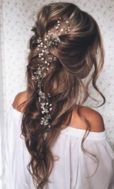 Long hair in loose waves pulled back with pearl & crystal hair accessory – wedding hairstyles – feminine bridal look