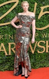 Gwendoline Christie wearing a sequin embellished Vivienne Westwood off the shoulder gown, at the 2015 British Fashion Awards. Celebrity style / red carpet fashion / designer gowns / glamour