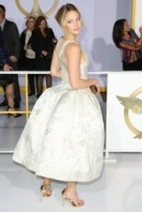 Jennifer Lawrence's red carpet style – In a white silk Dior gown at the L.A. premiere of The Hunger Games: Mockingjay – Part 1, November 2014. Celebrity fashion | star style gowns | designer dresses | events