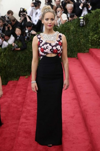 Jennifer Lawrence's red carpet style – wearing a Dior Couture gown at the 2015 Met Ball Gala in New York. Celebrity fashion   celebrities at events   gowns   star style