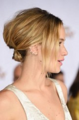 Jennifer Lawrence's loose updo at the Los Angeles premiere of The Hunger Games: Mockingjay – Part 1, November 2014. Celebrity updos | red carpet hairstyles | hair and beauty at events | messy buns