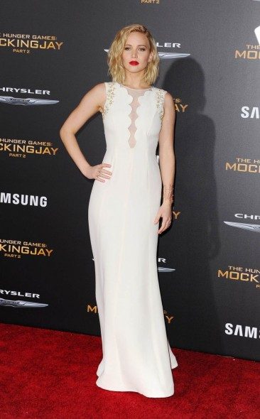 Jennifer Lawrence wearing a sleeveless Dior white gown attends The Hunger Games: MockingJay Part 2 Los Angeles premiere, 16 November 2015. Celebrity fashion | red carpet gowns star style | film premieres | events