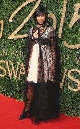 Naomi Campbell in Burberry at the 2015 British Fashion Awards. Celebrity style / red carpet fashion / designer outfits / sheer black lace cape