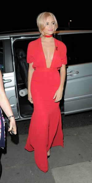 Pixie Lott wearing a long pink dress, with a deep plunging neckline, arrives at the Tunnel of Love fundraiser at the V&A Museum in London, 11 November 2015. Celebrity fashion | star style dresses | celebrities at events