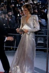 Princess Diana in March 1985 wearing a silver metallic Bruce Oldfield gown, while attending a fashion show gala in aid of the Barnardo's charity. Diana's style ~ royalty ~ royal fashion ~ gowns