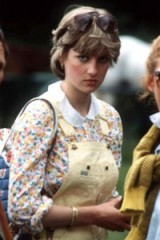 Lady Diana Spencer in 1981 wearing yellow dungarees over a floral blouse at a polo match in Midhurst, West Sussex, England. Diana's style ~ Princess Diana ~ royal fashion ~ royalty