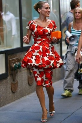 Only Carrie could get away with this look…red roses printed peplum dress, orange clutch and monochrome stripe peep toe shoes ~ SATC ~ Sex and the City style ~ SJP