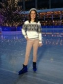 Laura Tobin looking festive on the ice in an accessorize.com hat and gloves, Primark sweater and Uniqlo.com trousers