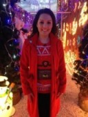 A lit up Laura Tobin wearing a mandco.com bright red coat and morphsuits.com Christmas jumper! #itsbeginingtolookalotlikeChristmas