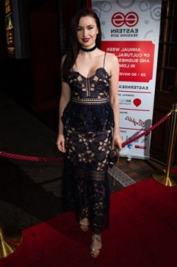 Emma Miller wearing a navy Self Portrait Amaryllis embroidered-lace dress, available from selfridges.com, at the Eastern Seasons' Gala Dinner at Madame Tussauds in London, 30 November 2015. Celebrity fashion | red carpet events | celebrities at events | floral lace dresses - flipped