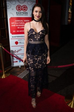Emma Miller wearing a navy Self Portrait Amaryllis embroidered-lace dress, available from selfridges.com, at the Eastern Seasons' Gala Dinner at Madame Tussauds in London, 30 November 2015. Celebrity fashion | red carpet events | celebrities at events | floral lace dresses