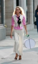 In the Sex and the City film, Carrie wore this tailored combination of white trousers and matching waistcoat with a pink candy stripe shirt and peep toe sandals ~ SATC ~ Carrie Bradshaw outfits ~ #SJP