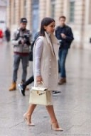 Miroslava Duma street style chic wearing a cream sleeveless coat with wide lapels – neutrals – neutral outfits – coats