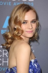 Diane Kruger's honey toned hair falling in soft ringlets. Red carpet hairstyles | celebrity make up and beauty
