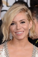 Sienna Miller's blonde tousled bob tucked behind one ear. Red carpet hairstyles | celebrity hair | make up and beauty
