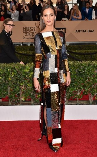 SAG Awards red carpet fashion – Alicia Vikander shimmered wearing a multi-coloured sequin patchwork style Louis Vuitton gown, January 2016. Celebrity dresses | celebrities at events | star style - flipped