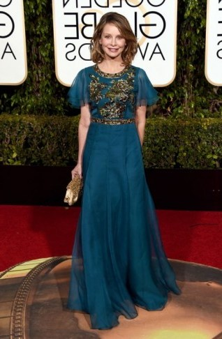 Calista Flockhart wearing a floaty teal Andrew GN gown, 10 January 2016 – Golden Globe Awards, Beverly Hilton Hotel, Beverly Hills, California. Celebrity fashion | star style | designer gowns | celebrities at red carpet events | Golden Globes - flipped