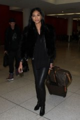 Model Chanel Iman travel style at LAX airport, 6 Jan 2016. Celebrity winter style – celebrities travelling – star fashion – fur jackets