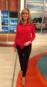 Kate Garraway looking sleek in a red top and black trousers