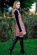 Olivia Palermo looked perfect as usual in a sleeveless plaid pinafore dress worn over a black turtleneck sweater and black Jimmy Choo leather over the knee boots – front row at Dior PFW Haute Couture S/S 2016 – celebrity outfits – celebrities at fashion shows – style icons