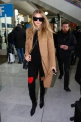 Gigi Hadid travel style arriving at Charles De Gaulle Airport on 19 Jan 2016 – celebrity outfits – celebrities travelling – models fashion – camel coat