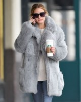 Olivia Palermo winter street style wearing a grey fur coat out in NYC, 15 Jan 2016. Celebrity style – casual fashion – warm fluffy coats – celebrities out and about