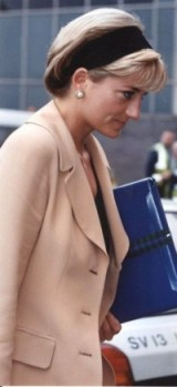 Princess Diana looking stylish in neutral tones with her sleek hair in a wide hairband