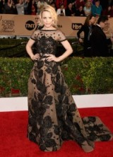 At the 2016 SAG Awards Rachel McAdams wore a beautiful nude short sleeved Elie Saab gown, which was covered in a black bead-embellished floral design and featured a full skirt with long train. Red carpet events | star style gowns | celebrity fashion | designer dresses