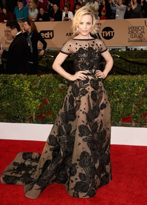 At the 2016 SAG Awards Rachel McAdams wore a beautiful nude short sleeved Elie Saab gown, which was covered in a black bead-embellished floral design and featured a full skirt with long train. Red carpet events | star style gowns | celebrity fashion | designer dresses - flipped