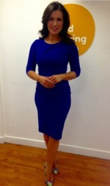 Susanna Reid standing in front of a giant egg by the looks of it in a DivaCatwalk.com blue dress and Office.co.uk shoes