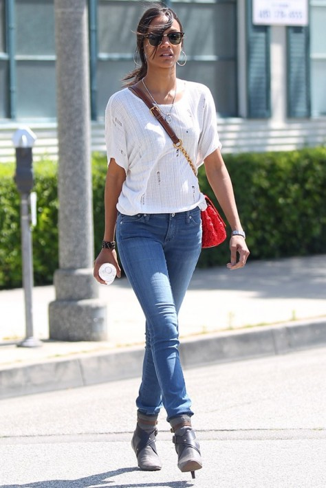 Zoe saldana street style in skinny jeans high heeled ankle boots Celeb style fashion uk
