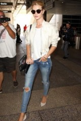 Rosie Huntington-Whiteley's casual chic style…round neck tee, satin cropped bomber, ripped skinny jeans and light grey pointy pumps. Celebrity travel outfits | celebrities in denim | models off duty
