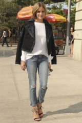 Olivia Palermo street style…white long sleeved top, black cropped jacket, ripped jeans and ankle tie barely there sandals. Celebrities in denim | casual star style | celebrity outfit inspiration